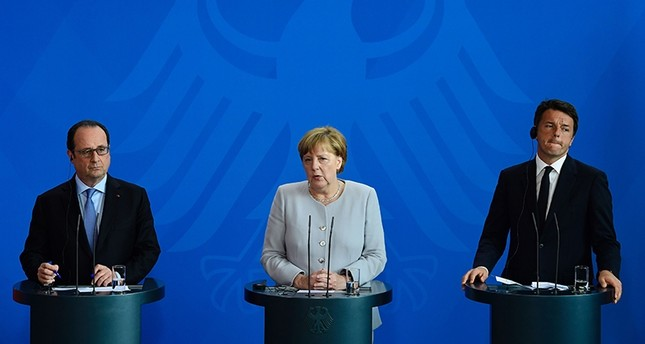 French President François Hollande, German Chancellor Angela Merkel and Italy's Prime Minister Matteo Renzi address a press conference ahead of talks following the Brexit referendum at the chancellery in Berlin, on June 27, 2016 (AFP Photo)