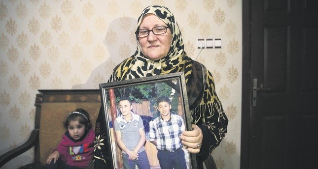 Meryem Şeyhani, 58, escaped from YPG brutality and migrated to the southern Turkish province of Şanlıurfa, where she currently lives in a rented house with her grandchildren.