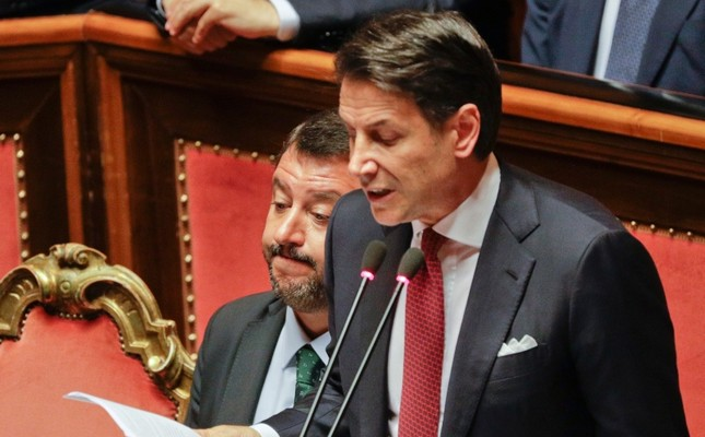 Italian Premier Giuseppe Conte, right, is flanked by Deputy-Premier Matteo Salvini as he addresses the Senate in Rome, Tuesday, Aug. 20, 2019. AP Photo