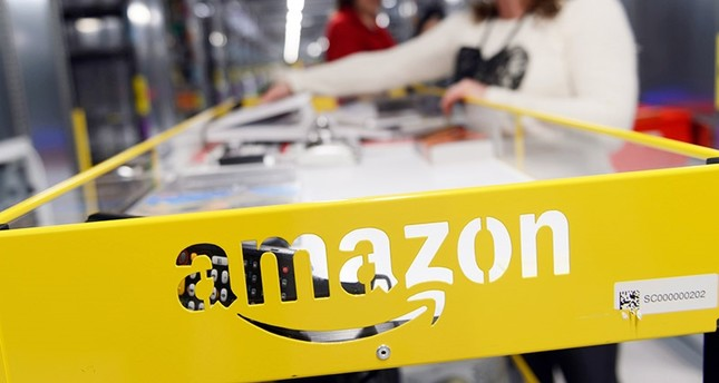 Workers at the Amazon e-trader's new logistics center in Sady, near Poznan, Poland, 24 October 2014. (EPA Photo)