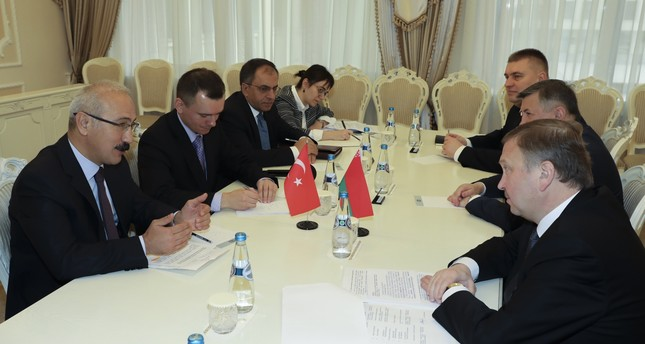 Development Minister Elvan (L) meets with Belarusian Prime Minister Kobyakov (R) while in Belarus, Oct. 18.