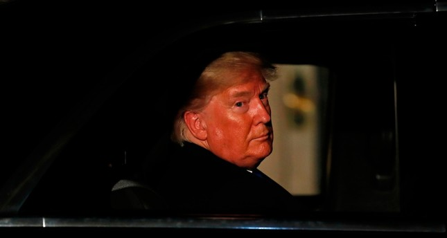 US President Donald Trump leaves 10 Downing Street in central London on December 3, 2019, after attending a reception hosted by Britain's Prime Minister Boris Johnson ahead of the NATO alliance summit. (AFP Photo)