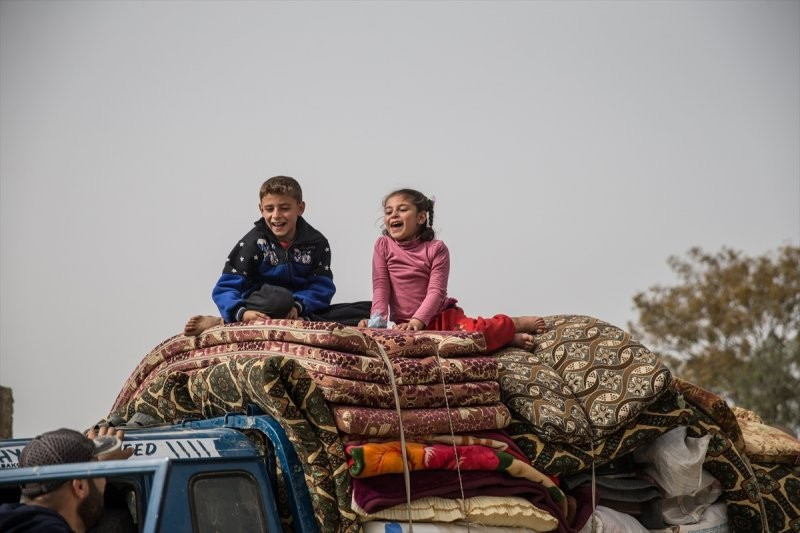 Syrian children are seen on a pickup truck with their familyu2019s belongings as they return to their homes in Afrin and Idlib, Syria on March 24, 2018.