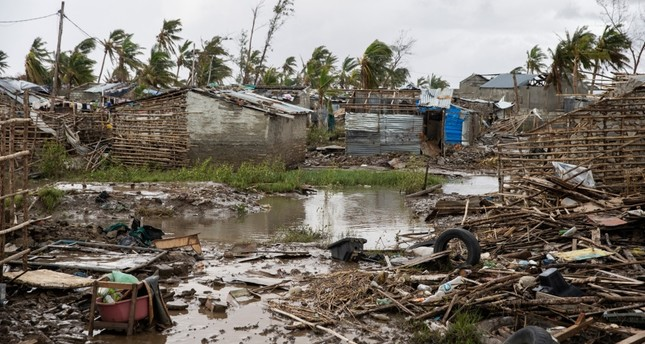 Flood water covers the ground  between rubble where there once use to be houses at an informal settlement in Beira, the fourth largest city in Mozambique, on March 23, 2019. AFP Photo