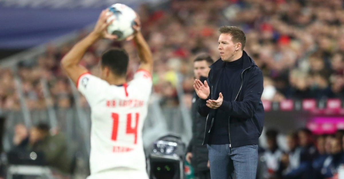 Leipzig's head coach Julian Nagelsmann, right, reacts during the German Bundesliga soccer match between Bayern Munich and RB Leipzig at the Allianz Arena in Munich, Germany, Sunday, Feb. 9, 2020. (AP Photo)