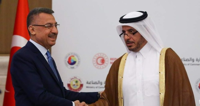 Vice President Fuat Oktay L and Qatari Prime Minister and Interior Minister Abdullah bin Nasser bin Khalifa Al Thani shake hands during the Turkey-Qatar Business Forum in Ankara, Nov. 1, 2019. ?HA Photo