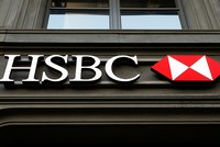 London-based bank HSBC reported Tuesday that its annual profit slumped by more than 80 percent following a year of