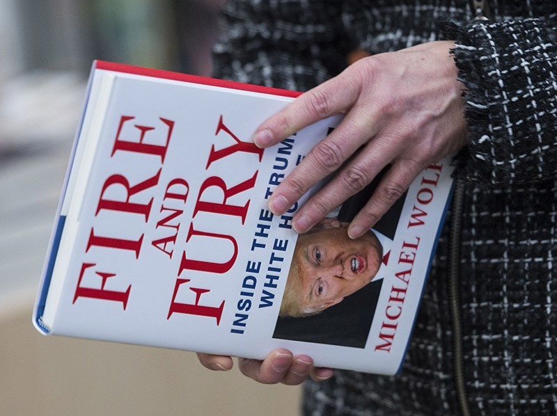 A man holds a copy of the book ,Fire and Fury: Inside the Trump White House, by Michael Wolff after buying it at a bookstore in Washington, D.C., U.S., Jan. 5, 2018. (AFP Photo)