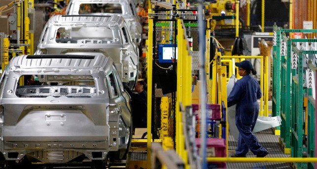 In this file photo taken on June 24, 2019 workers assemble cars at the newly renovated Ford's Assembly Plant in Chicago. AFP Photo