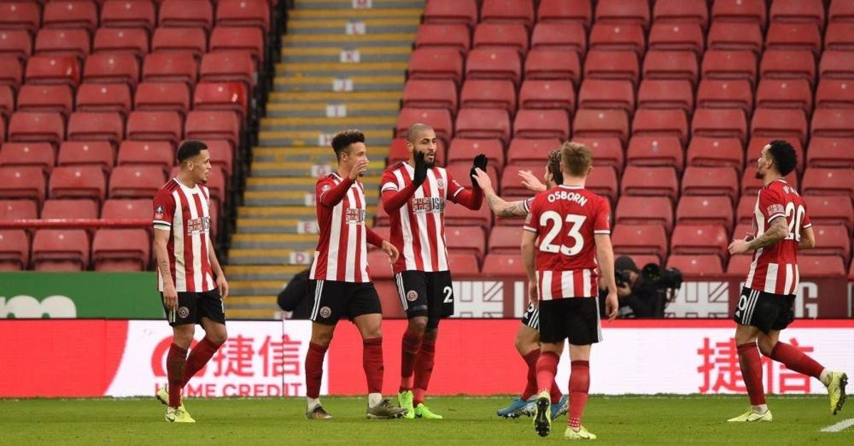 Sheffield United players celebrate their second goal in front of empty seats during the FA Cup third round match against Fylde, Jan. 5, 2020. (AFP Photo)
