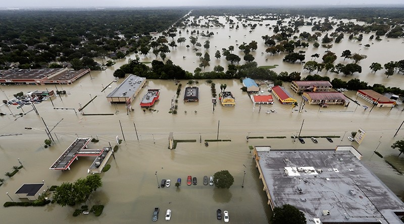 In this Aug. 29, 2017 file photo, water from Addicks Reservoir flows into neighborhoods as floodwaters from Tropical Storm Harvey rise in Houston, Texas, U.S. (AP Photo)