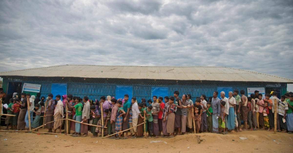 In this file photo dated Wednesday, Nov. 15, 2017, Rohingya Muslims, who crossed over from Myanmar into Bangladesh, wait in queues to receive aid at Kutupalong refugee camp in Ukhiya, Bangladesh. (AP Photo)