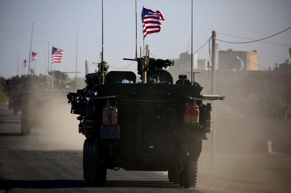 A convoy of U.S. armored vehicles near the village of Yalanli, western Manbij, Syria, March 5, 2017.