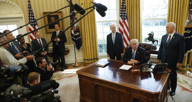 Trump, accompanied by Secretary of Health and Human Services Tom Price (L) and Vice President Mike Pence (R), meeting with members of the media in the Oval Office of the White House, Washington D.C., March 24. (AP Photo)
