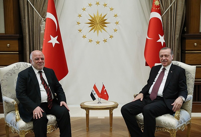 President Recep Tayyip Erdou011fan (R) and Iraqi Prime Minister Haider al- Abadi pose for a photo before a meeting at presidential palace, Ankara, Turkey, Oct. 25, 2017. (PresIdential Press Service)