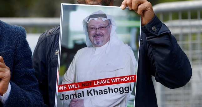 A demonstrator holds picture of Saudi journalist Jamal Khashoggi during a protest in front of Saudi Arabia's consulate in Istanbul, Turkey, October 5, 2018. (REUTERS Photo)