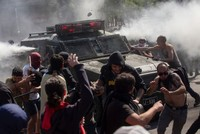 Death toll grows in Chile protests over metro price hikes