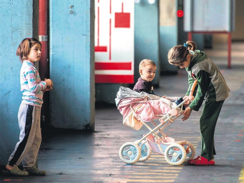 Children play in a building converted into refugee accommodations, Frankfurt, Germany.