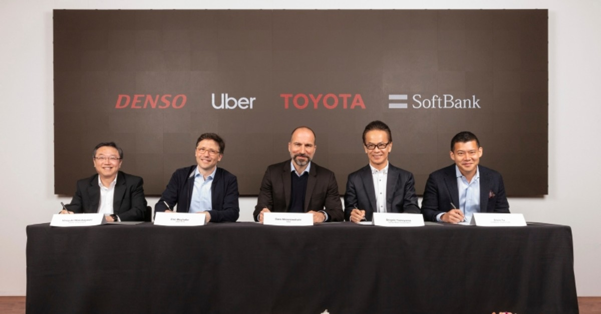 In this Thursday, April 18, 2019, photo provided by Toyota shows Denso, Uber, Toyota, Softbank executives attending a press conference at Uber headquarters in San Francisco. (AP Photo)
