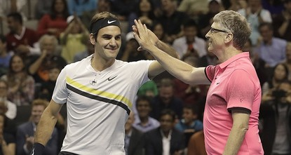 Federer hits the court with Bill Gates in charity event