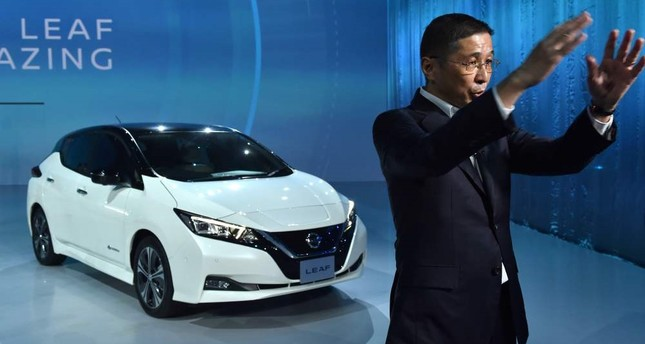 Japan's Nissan Motor President and CEO Hiroto Saikawa speaks in a television interview with the company's new Nissan LEAF, the next evolution of the zero-emission electric vehicle, at the world premiere, yesterday.