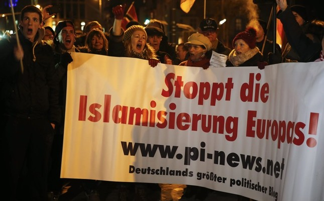 People take part in a march organized by an anti-Muslim movement in Cologne, Jan. 5, 2015.