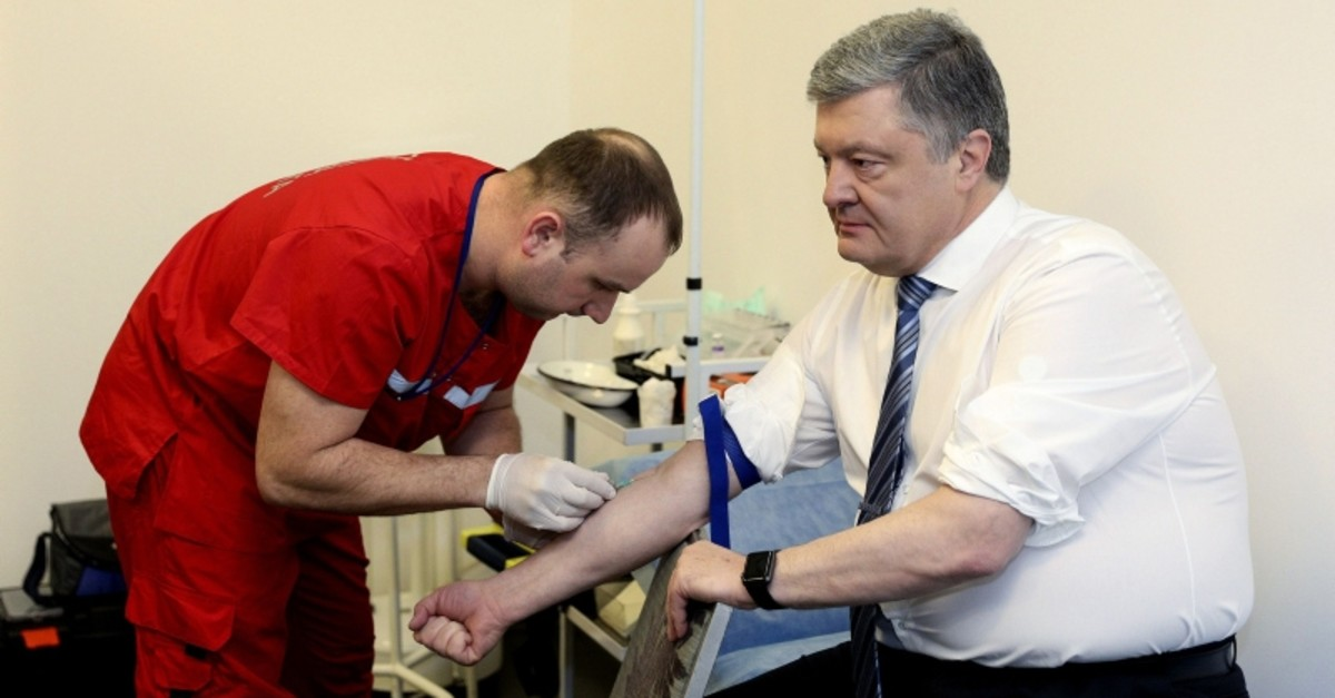 Ukraine's President Petro Poroshenko takes a blood test in Kiev, Ukraine, Friday, April 5, 2019. (AP Photo)