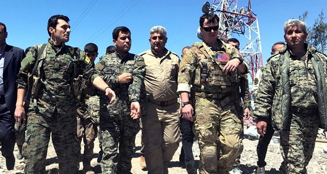 Senior PKK militant Şahin Cilo (2nd from left), who is on the Interior Ministry's most-wanted terrorist list with a bounty of TL 4 million, and a U.S. commander (2nd from right).