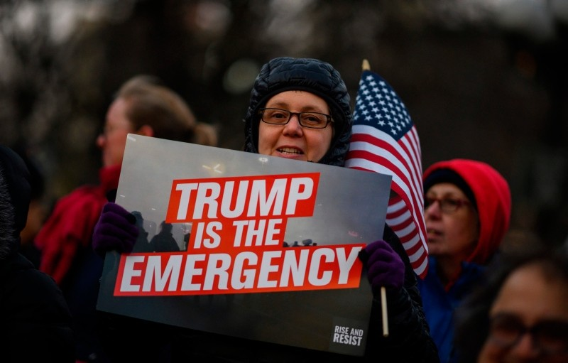 Demonstrators participate in a President's Day protest against US President Donald Trump immigration policy at the Union Square on February 18, 2019 in New York City. (AFP Photo)