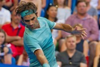 Roger Federer showed no signs of rust in his first competitive match for six months when he outclassed Dan Evans 6-3 6-4 at the Hopman Cup yesterday. The 17-time grand slam winner underwent knee...