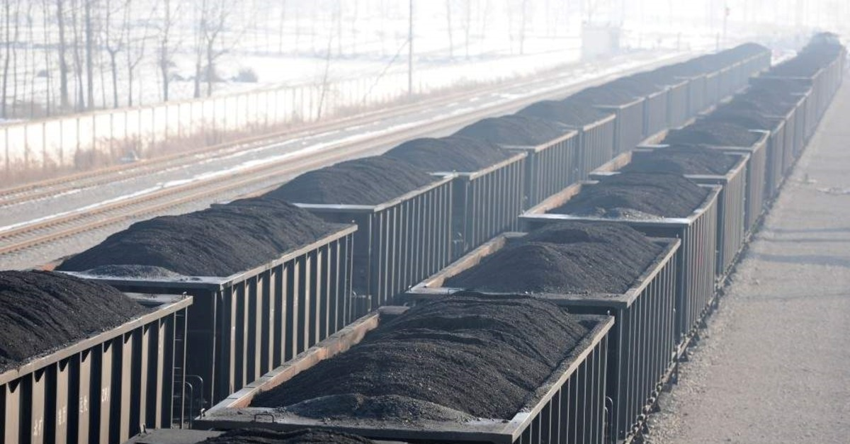 Carriages loaded with coal are seen at a mine pit of Huaibei Mining Group. (China Daily via Reuters)