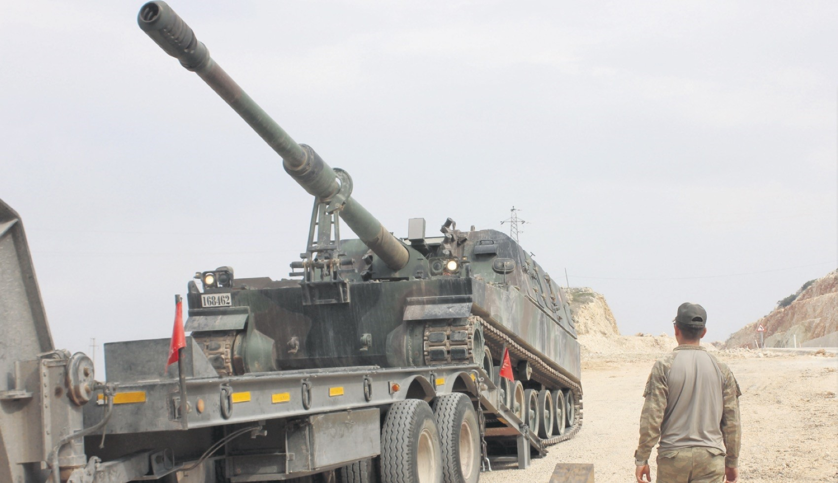 A Turkish soldier oversees a military vehicle being loaded onto a truck before it heads to one of the 12 Turkish observation points in Idlib, northwestern Syria, Sept. 13.