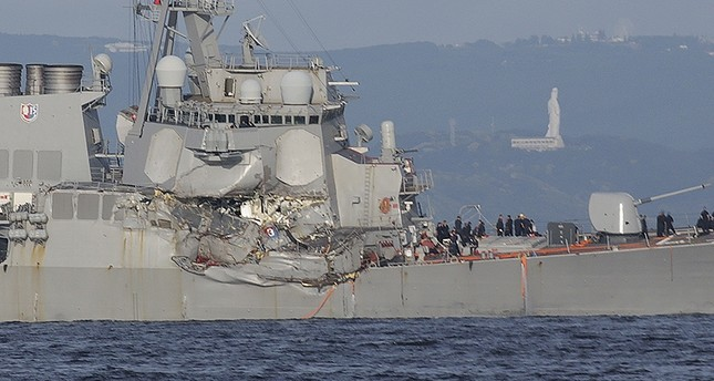 The damaged USS Fitzgerald is seen near the U.S. Naval base in Yokosuka, southwest of Tokyo, after the U.S. destroyer collided with the Philippine-registered container ship ACX Crystal in Japanese waters. (AP Photo)