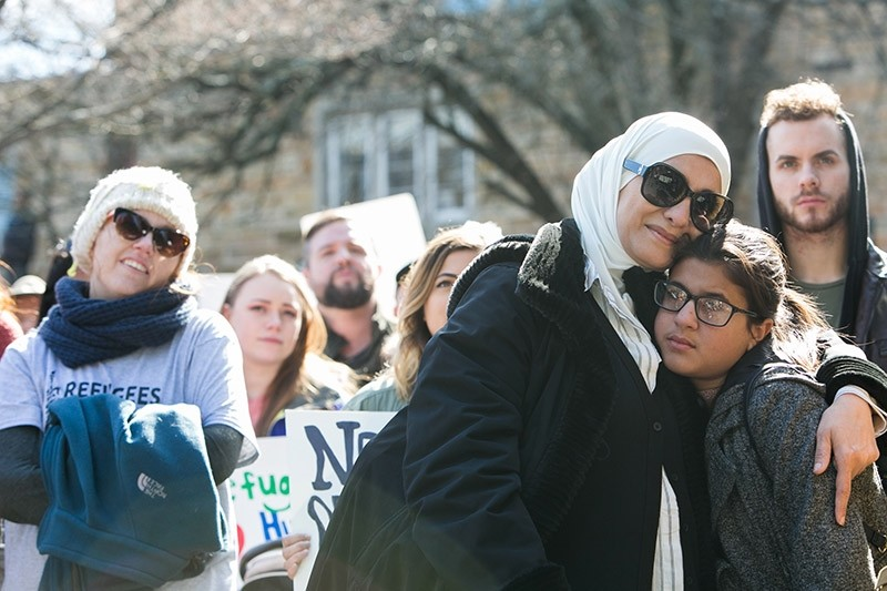 Palestinian immigrant and American citizen Kareema (left) hugs her daughter, Jenna, 13, during an Interfaith Rally for Muslims and Refugees on February 4, 2017 in Georgia. (AFP Photo)