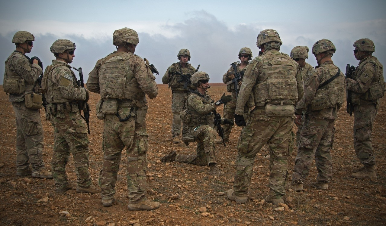 U.S. soldiers gather for a brief during a combined joint patrol rehearsal in Manbij, Syria, Nov. 7.