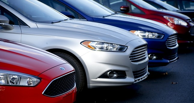 In this Nov. 19, 2015, photo, a row of new Ford Fusions are for sale on the lot at Butler County Ford in Butler, Pa. (AP Photo)