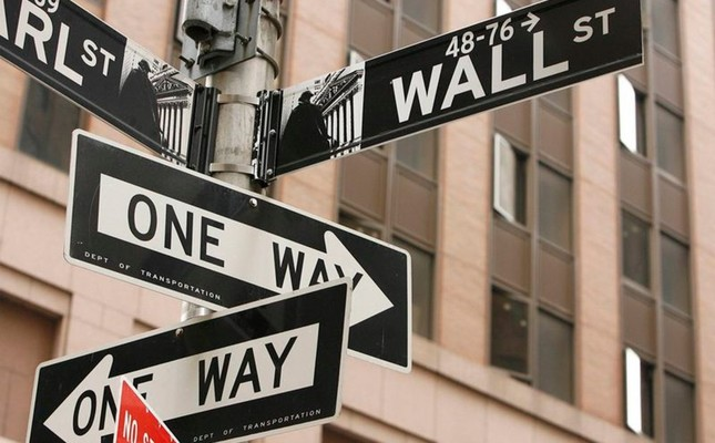The famous One Way and Wall Street signs in southern Manhattan, New York.