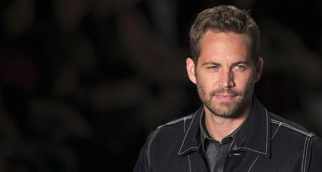 U.S. actor Paul Walker presents a creation from Colcci's 2013/2014 summer collection during Sao Paulo Fashion Week in this March 21,2013 file photo. (Reuters Photo)