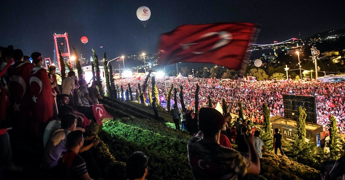 People gather at the 15 July Martyrsu2019 Bridge to attend the anniversary ceremony of the July 15, 2016 coup attempt, Istanbul, July 15, 2018.