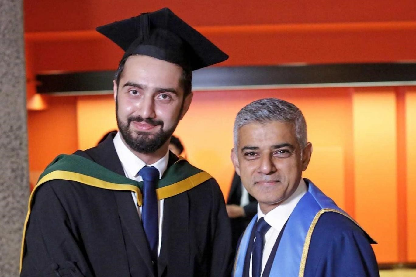 Tirej Brimo poses with London Mayor Sadiq Khan at his graduation ceremony St George's, University of London.