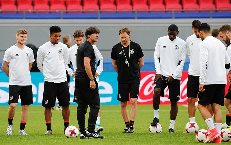 German national soccer team head coach Joachim Loew (C left) and assistant coach Marcus Sorg during a training session at Kazan Arena, in Kazan, Russia, 21 June 2017. (EPA Photo)