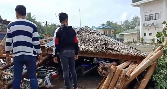 Handout video grab taken Oct. 29, 2019 from the Facebook page of Anthony Allaga shows residents standing next to motorcycles under a temporary shelter after it collapsed during a 6.6-magnitude earthquake in Magsaysay on Mindanao island. (AFP Photo)