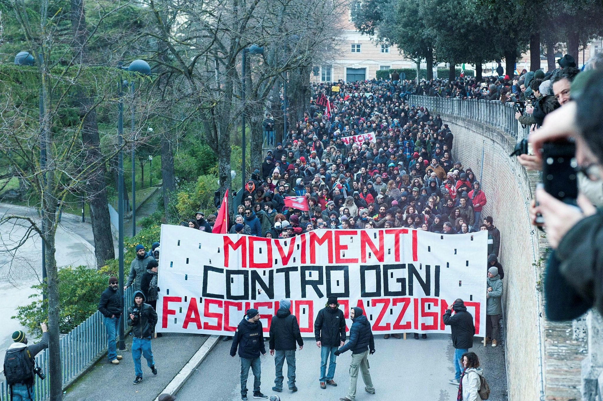 Demonstrators march during an anti-racism rally in Macerata, Italy, Feb. 10.