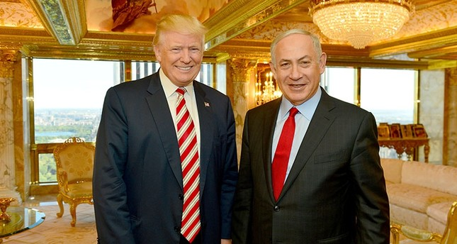 Israeli Prime Minister Benjamin Netanyahu R stands next to Republican U.S. presidential candidate Donald Trump during their meeting in New York, September 25, 2016. Handout photo via Reuters