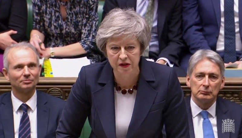 A video grab from footage broadcast by the UK Parliament's Parliamentary Recording Unit (PRU) May as she speaks during the weekly Prime Minister's Questions (PMQs) in the House of Commons in London on January 9, 2019. (AFP Photo)