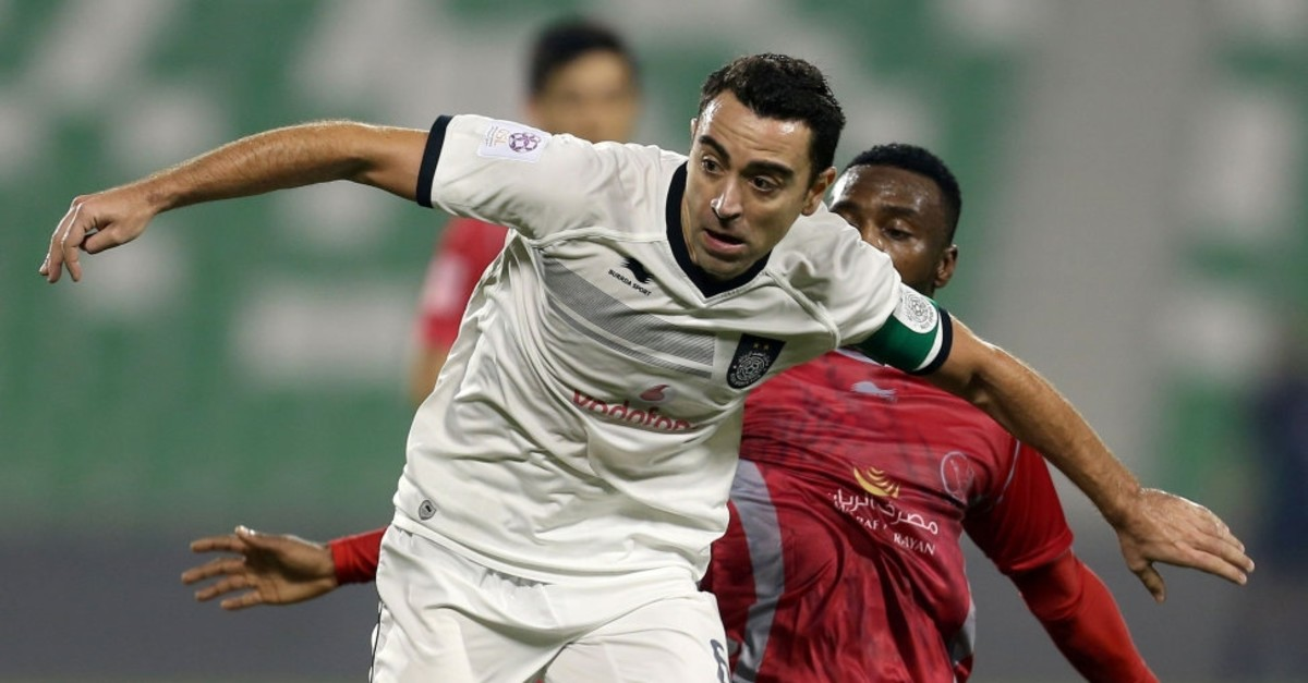 Xavi fights for all against Lekhwiya's Ismail Mohammed in a match in Doha, Jan. 21, 2016.