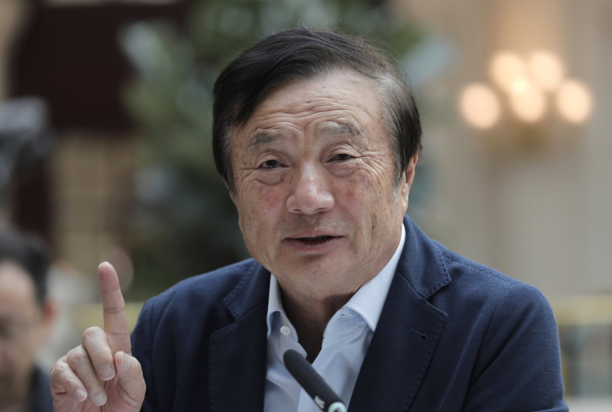 Ren Zhengfei, founder and CEO of Huawei, gestures during a round table meeting with the media in Shenzhen city, south China's Guangdong province, Tuesday, Jan. 15, 2019. (AP Photo)