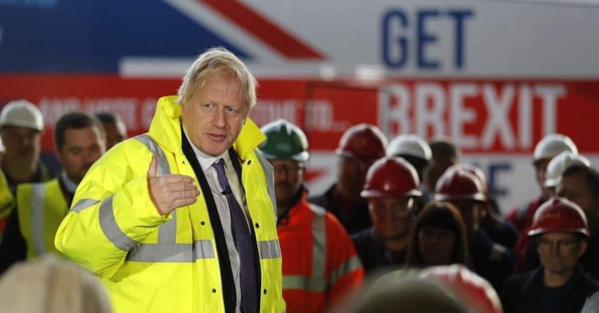 Britain's Prime Minister Boris Johnson speaks to workers during a visit to Wilton Engineering Services,  Middlesbrough, Nov. 20, 2019. (AP Photo)