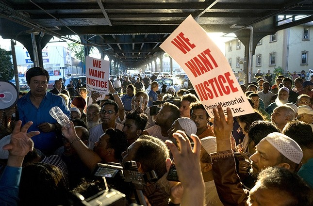 People gather for a demonstration Saturday, Aug. 13, 2016, in the Queens borough of New York, near a crime scene after the leader of a New York City mosque and an associate were fatally shot as they left afternoon prayers. AP Photo