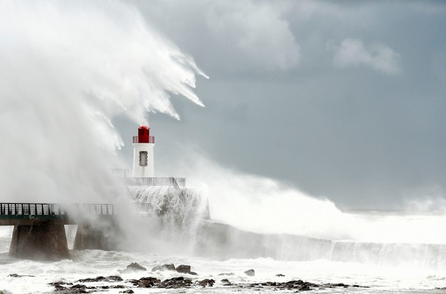 Large waves hit the lighthouse which guides to the entrance of the harbour in Les Sables-d'Olonne, western France. AFP Photo